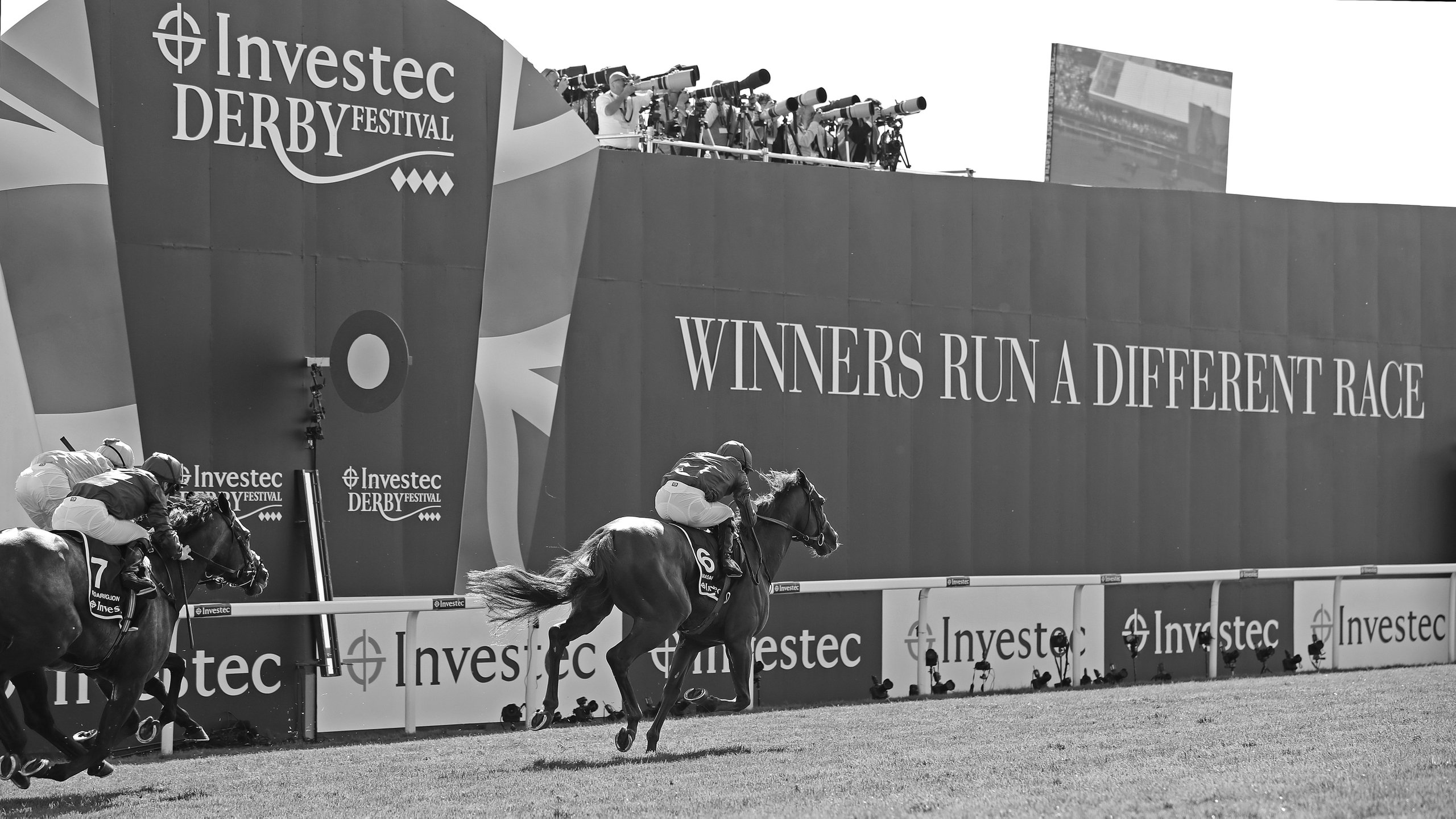 Masar winning the 2018 Investec Epsom Derby taken by Debbie Burt
